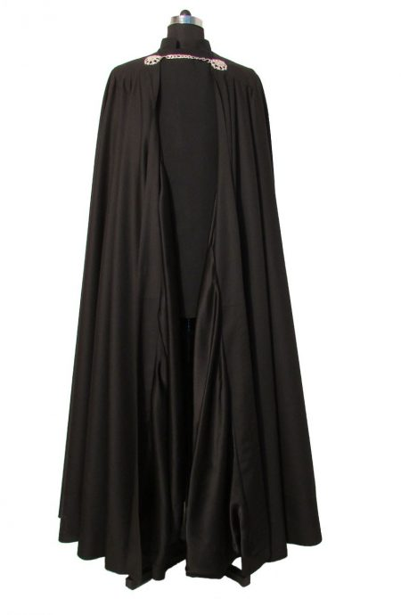 Destination beach wedding suit with a cape. Full front view.