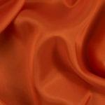 Orange acetate fabric for garment lining.