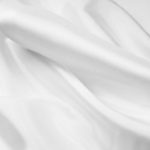 White acetate fabric for garment lining.