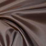 Brown acetate fabric for garment lining.