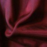 Burgundy acetate fabric for garment lining.
