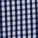 100% poplin cotton in a midnight gingham pattern ideal for shirts, dresses, skirts, pants, and unstructured blazers.