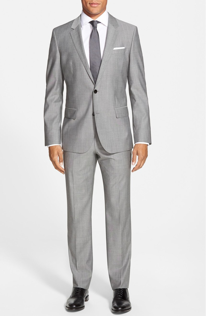 Mens 2 button suit in silk and wool blend.