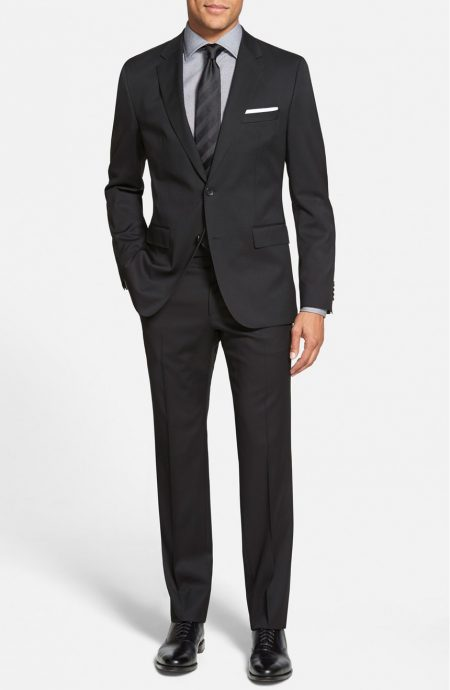 Mens black suit in tropical wool, a full front view.