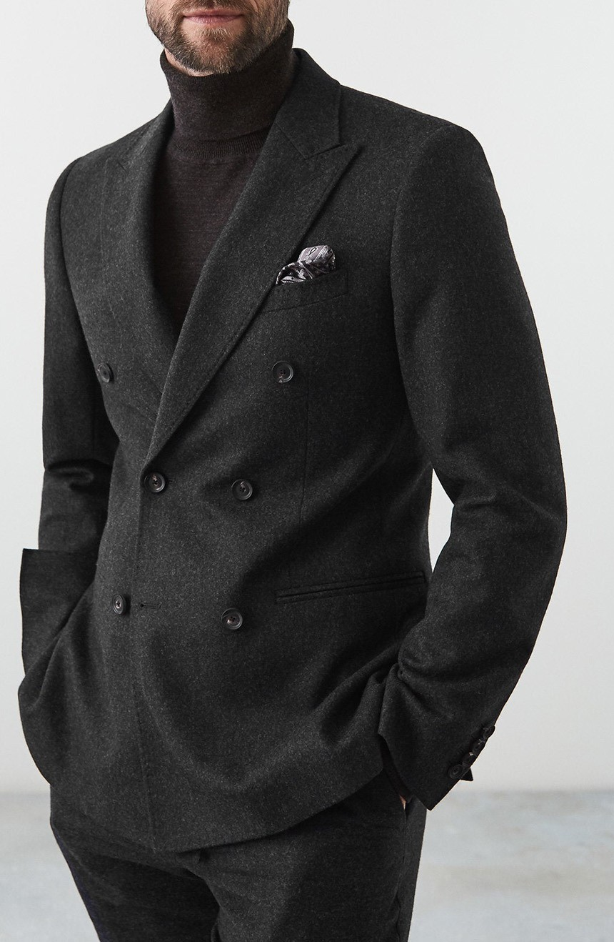 Mens double-breasted suit jacket full front view.