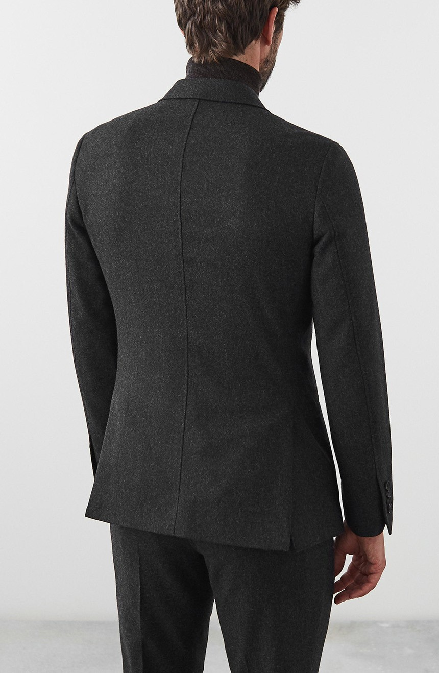 Mens double-breasted suit jacket full back view.