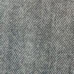 A light gray medium weight Italian tweed with a herringbone pattern.