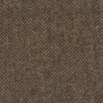 A light brown medium weight Italian tweed with a herringbone pattern.