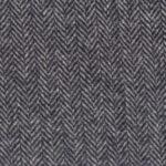 A mid gray medium weight Italian tweed with a herringbone pattern.