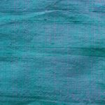 Dupioni silk fabric in sea green color ideal for suits, jackets, blazers, pants, dresses, skirts, and vests.