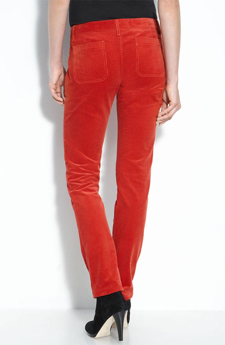 Red velvet mid-rise womens skinny pants with pockets full back view.