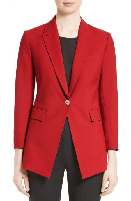 Womens red wool blazer jacket fitted with lapels, collar, and buttons.