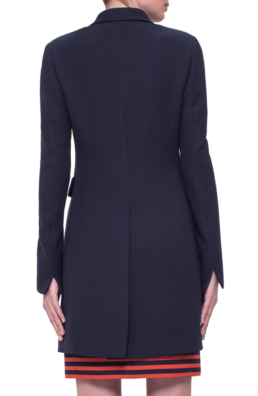 Women's tailor-fitted coat full back view.