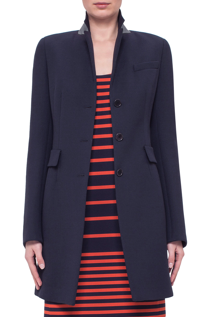 Womens tailored fitted coat in a vented style suitable for long winter.