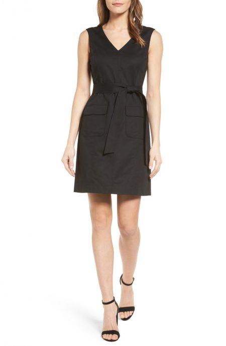 Belted V-neck shift dress with pockets and knee-length.
