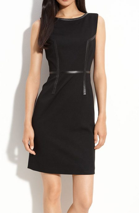 Black dress with leather trims in sleeveless cut with zipper back closure.
