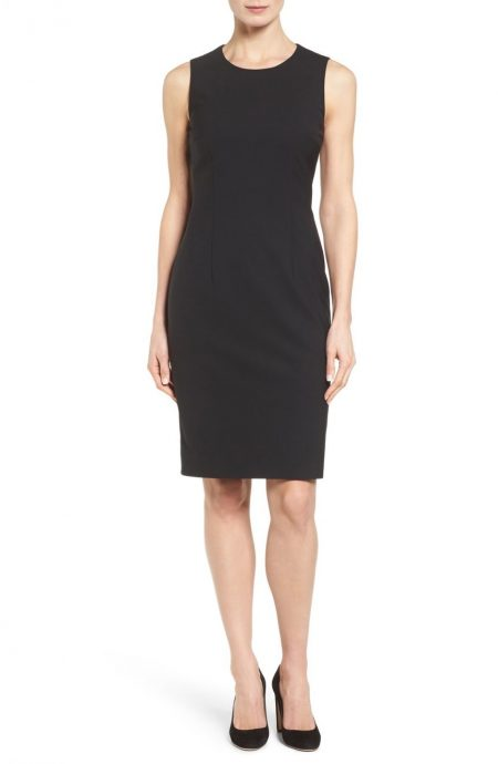 Classic black sheath evening dress tailored with round neck.