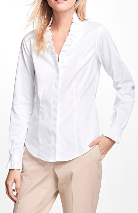 Womens white ruffle collar shirt with long ruffle sleeves.