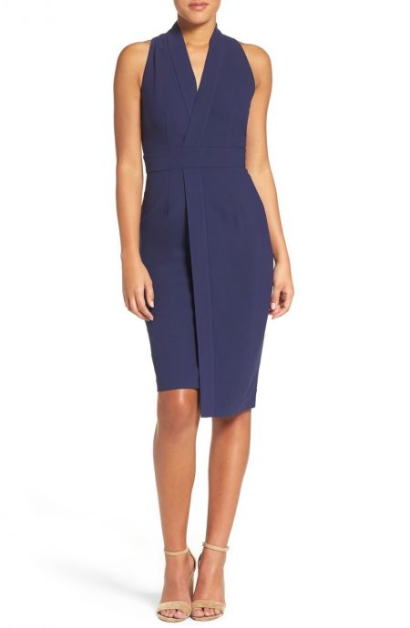 Crossover design wrap dress with collar, V-neck front, and knee-length.