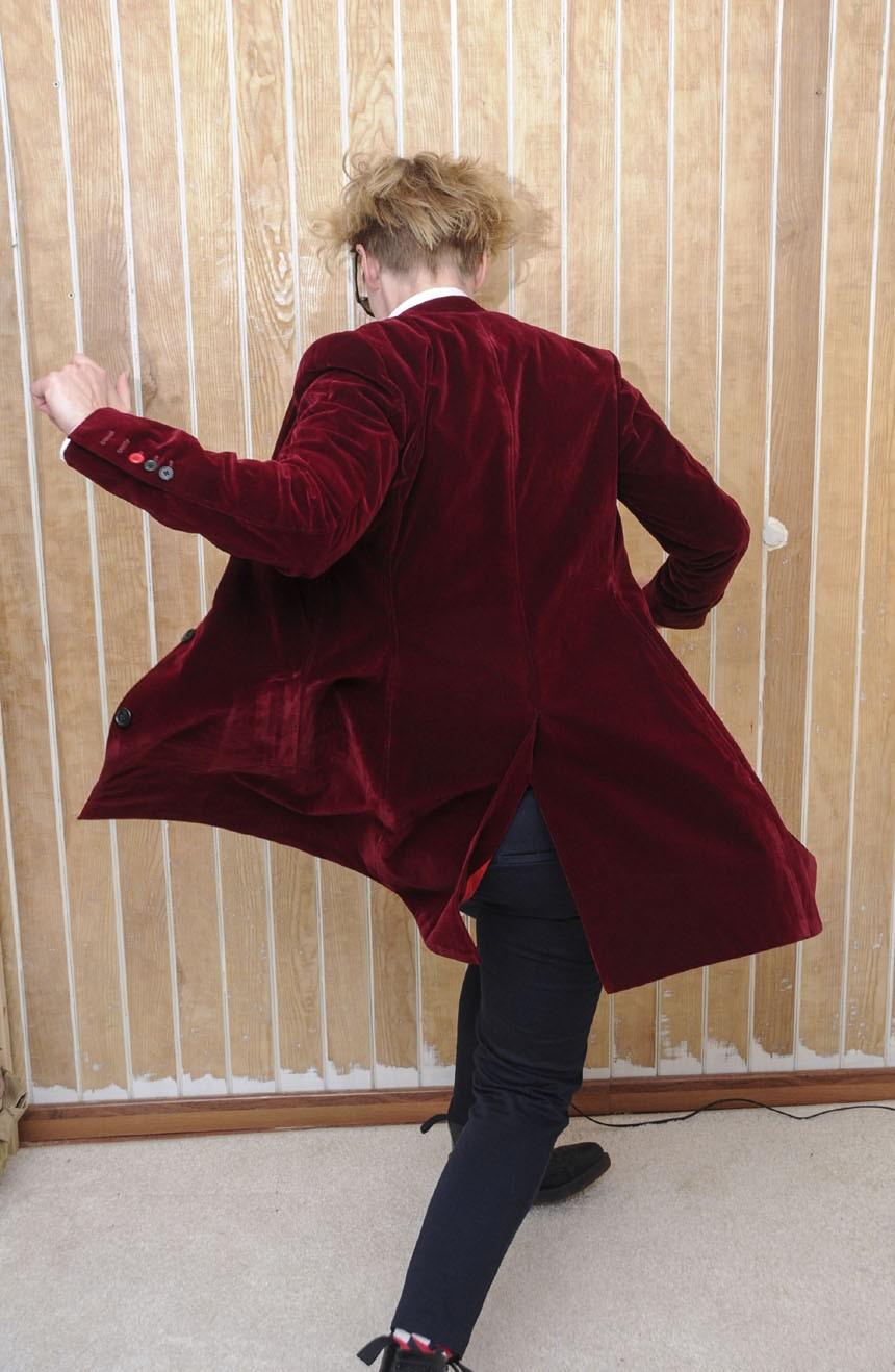 Womens burgundy velvet coat replica from the 12th Doctor Who back swing view.