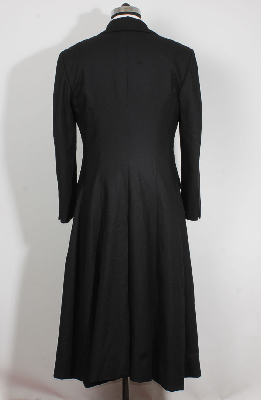 Womens long black trench coat in wool inspired by The Matrix Revolutions style a full back view.