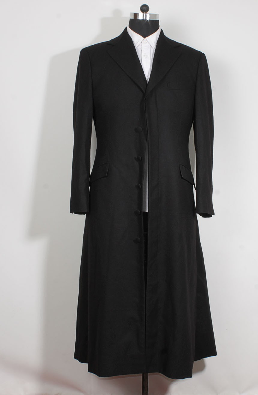 Womens long black trench coat in wool inspired by The Matrix Revolutions style a full front view.