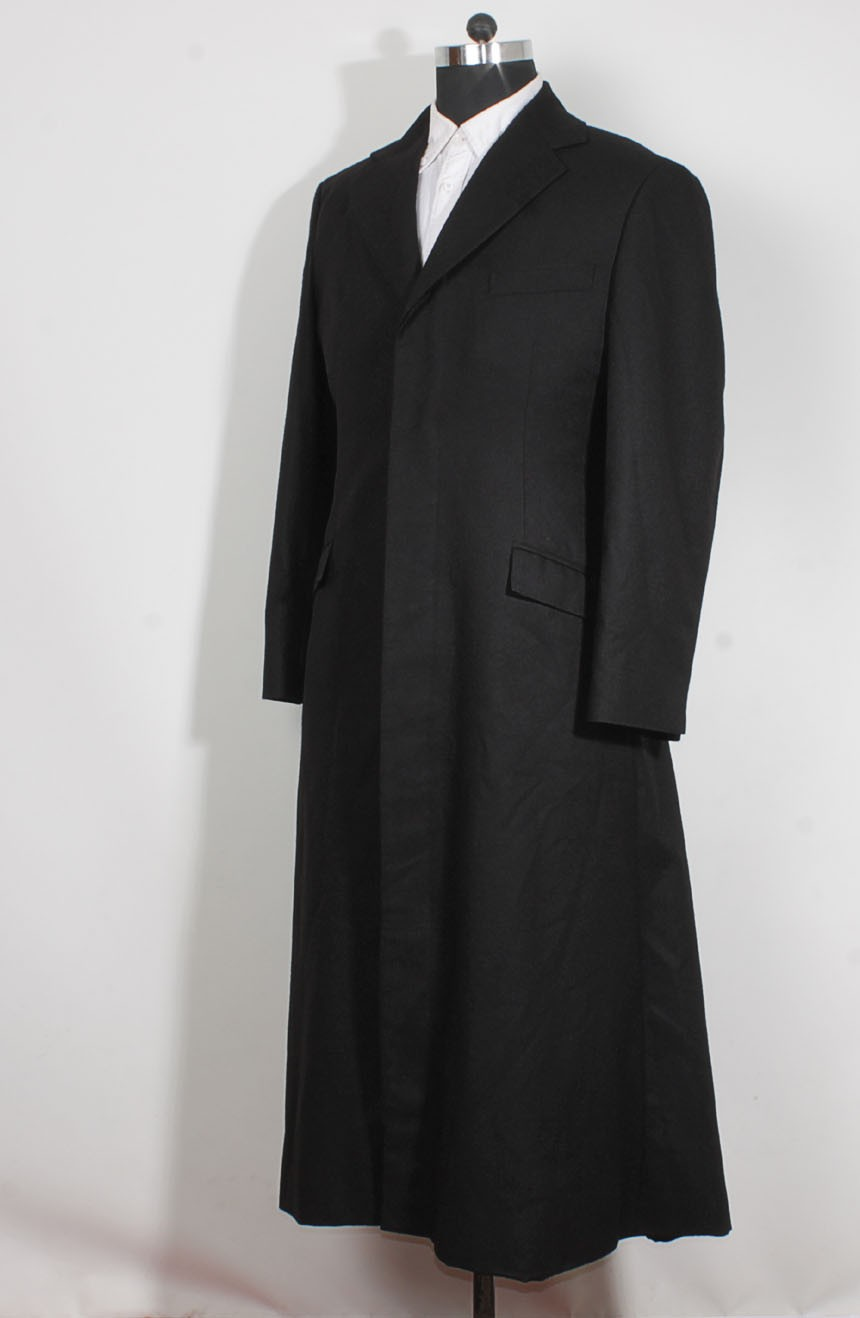 Womens long black trench coat in wool inspired by The Matrix Revolutions style a full side view.
