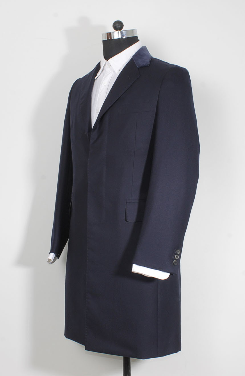 Womens navy Crombie coat replica from Spectre in 007 James Bond style a side back view.