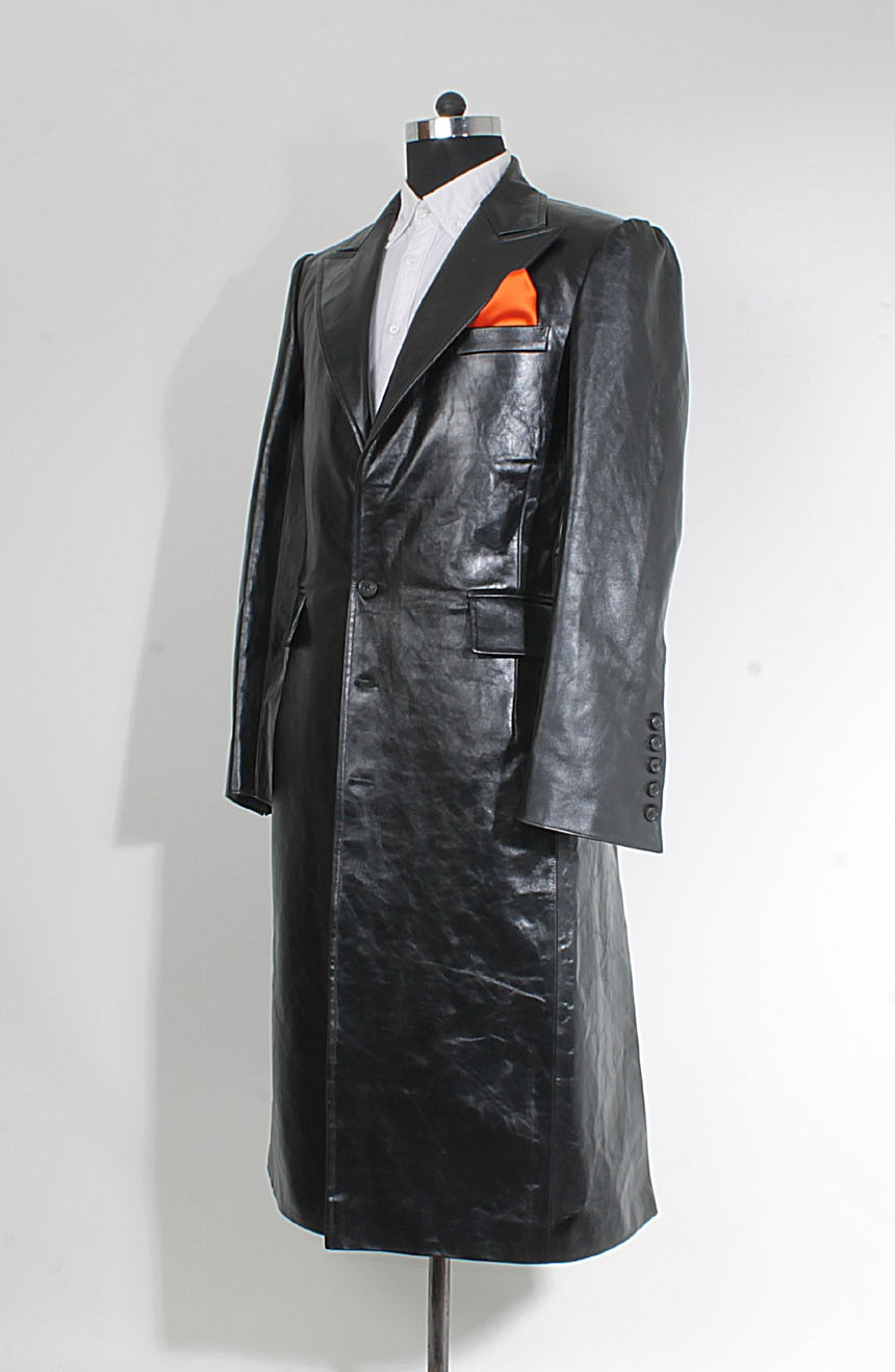 Joker trench coat in black leather inspired from The Dark Knight. A full side view.