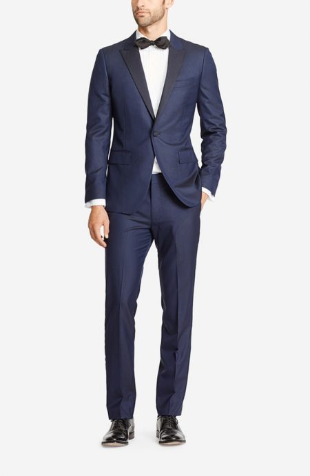 Navy blue wedding tuxedo with black silk satin lapel. A full front view.