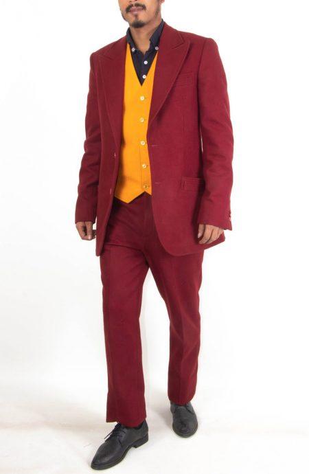 Arthur Fleck Joker suit replica starring Joaquin Phoenix in the 2019 Joker movie. A full walking view.