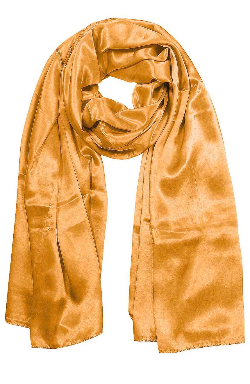 Womens silk neck scarf in ginger 22×75 inches with plenty of material to wrap around the head or shoulders in many ways.