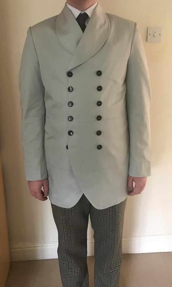 1st Doctor Who black dress coat try-on test garment, full front view.