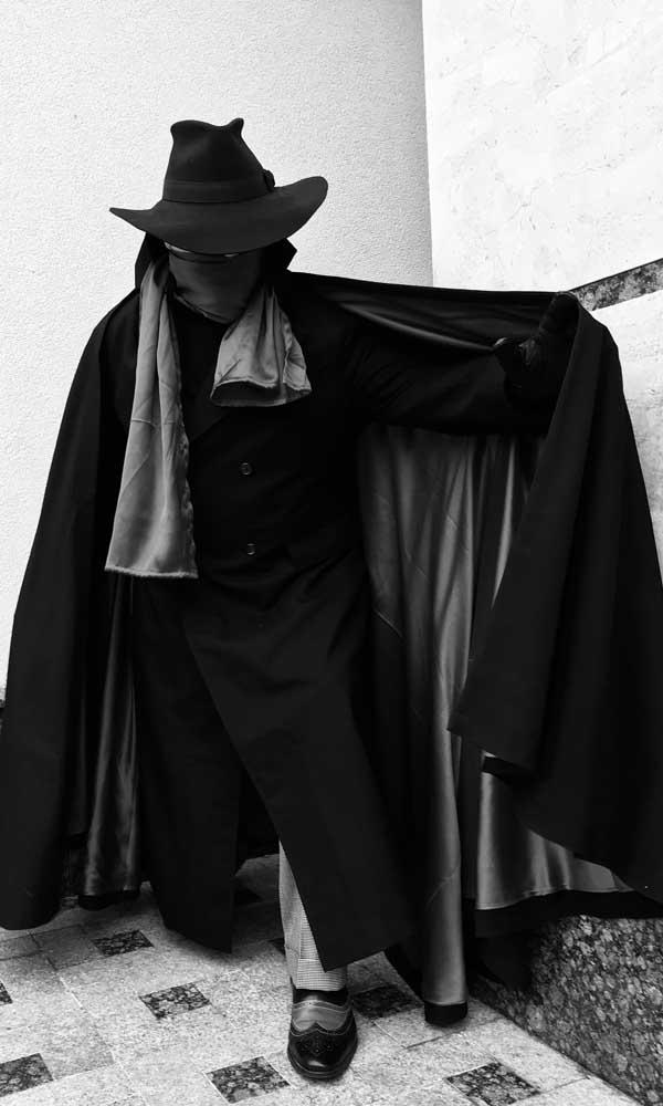 A happy customer in the shadow coat costume in the dark shadow look.